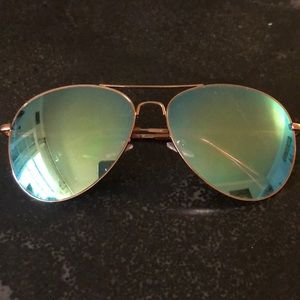 Rose gold with turquoise lens sunglasses